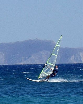 Mat windsurfing in sunnier climes, probably turkey